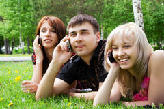 Young people on the phones. Stock Images