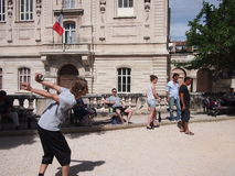 Young people play boules in the sun royalty free stock photography