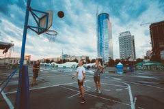 Young people play street basketball in the center Stock Photo