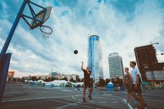 Young people play street basketball in the center Stock Image