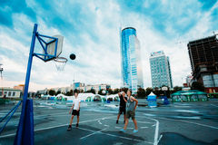 Young people play street basketball in the center Royalty Free Stock Photos