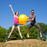 Young people play with yellow ball Royalty Free Stock Photography