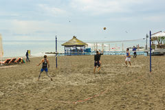 Young people playing beach volleyball on the sand at the Black sea Stock Photo