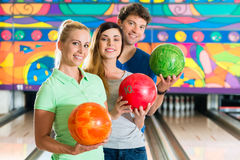 Young people playing bowling and having fun Royalty Free Stock Images