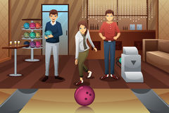 Young people playing bowling Stock Photo