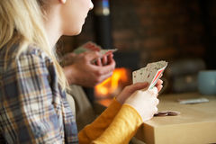 Young people playing cards. Inside Stock Photography