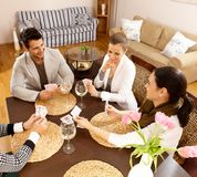Young people playing cards at home Stock Images