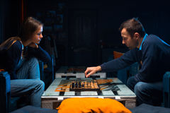 Young people playing chess. In the games room Stock Photography