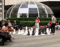Young people playing street chess near Vancouver`s Pacific Centre. BC, Canada stock photo