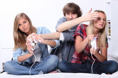 Young people playing computer games royalty free stock photo