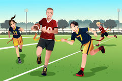 Young people playing flag football Royalty Free Stock Photo