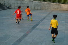 Young people are playing football Royalty Free Stock Photo