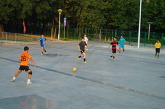 Young people are playing football Royalty Free Stock Images