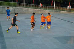 Young people are playing football Stock Image