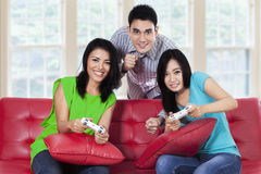Young people playing games at home Royalty Free Stock Photos