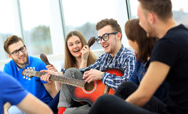 Young people playing guita Royalty Free Stock Photo