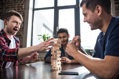 Young people playing jenga game Royalty Free Stock Images