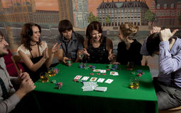 Young people playing poker. Royalty Free Stock Photos