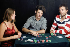 Young people playing poker off-line tournament Royalty Free Stock Photos