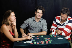 Young people playing poker off-line tournament. Betting call emotional Royalty Free Stock Photos