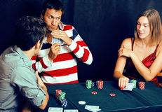Young people playing poker off-line tournament, friends party co Royalty Free Stock Photo
