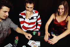 Young people playing poker off-line tournament, friends party co Stock Image