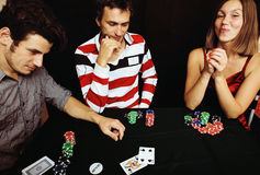 Young people playing poker off-line tournament, friends party co Stock Photography