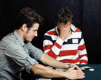 Young people playing poker Stock Image
