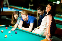 Young people playing pool Stock Photo