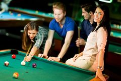 Young people playing pool Stock Image