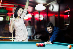 Young people playing snooker in a club pub bar Stock Image