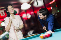Young people playing snooker in a club pub bar Royalty Free Stock Images