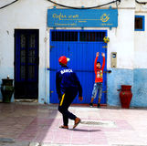 Young people playing soccer in the medina of Essaouira stock image