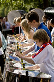 Young people playing steel drums. Young people from the Croydon Steel Orchestra playing steel drums at the Notting Hill Panorama Championships in Hyde park Stock Photography
