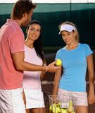 Young people playing tennis Royalty Free Stock Image