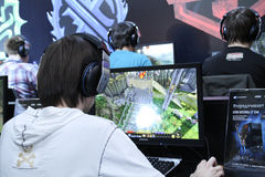 Young people playing video games stock images