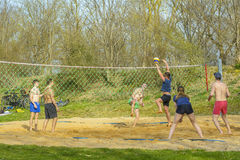 Young people playing volley Royalty Free Stock Photos