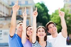 Young people pointing up Stock Photos