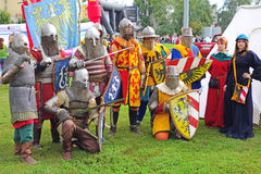 Young people posing in medieval costumes Royalty Free Stock Photo