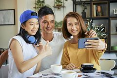 Young people posing for selfie stock photography