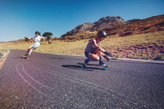 Young people practicing long board riding Royalty Free Stock Photo