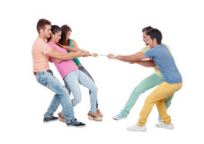 Young people pulling a rope. Isolated on a white background Stock Photos