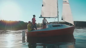 Young people`re sailing in the bay stock video footage