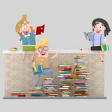 Young people reading on a brick wall Royalty Free Stock Image