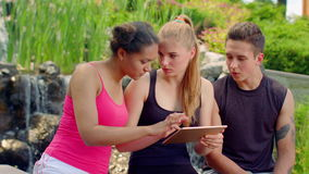 Young people reading news on tablet. Shocked people stock video