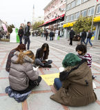 Young people reading street. Istanbul, Turkey - November 16, 2014: Young people are reading books and painting on a street in Istanbul Stock Photos