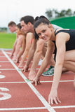 Young people ready to race on track field Stock Photography
