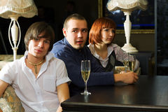 Young people relaxing in a bar. Stock Image