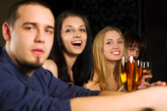 Young fashion people relaxing in a night bar Royalty Free Stock Photo