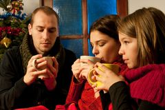 Young people relaxing with tea Royalty Free Stock Photos